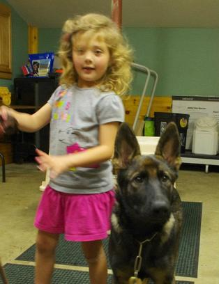 4 1/2-year-old Faith and 5-month-old German shepherd dog Aiko